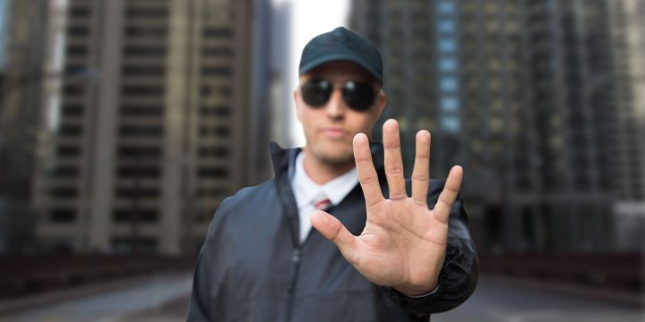 Security Guard with Hand Out